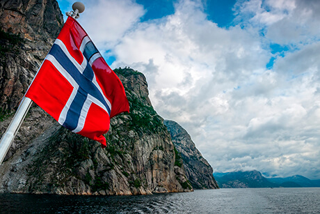 The flag flow on the cruise in Norwegian fjord.